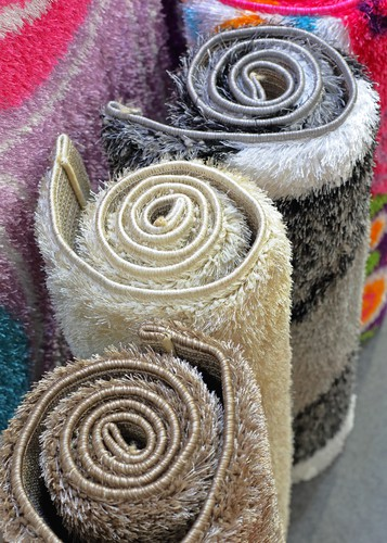 Synthetic carpets and rugs in rolls