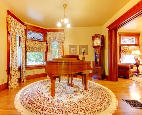 Circular rugs make great additions in a home at areas with bay windows.