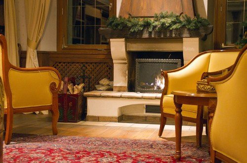 Oriental rug in seating area next to the fireplace