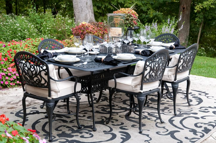 You can enhance your seating area and prepare it for a great dinner party with an eye-catching outdoor rug