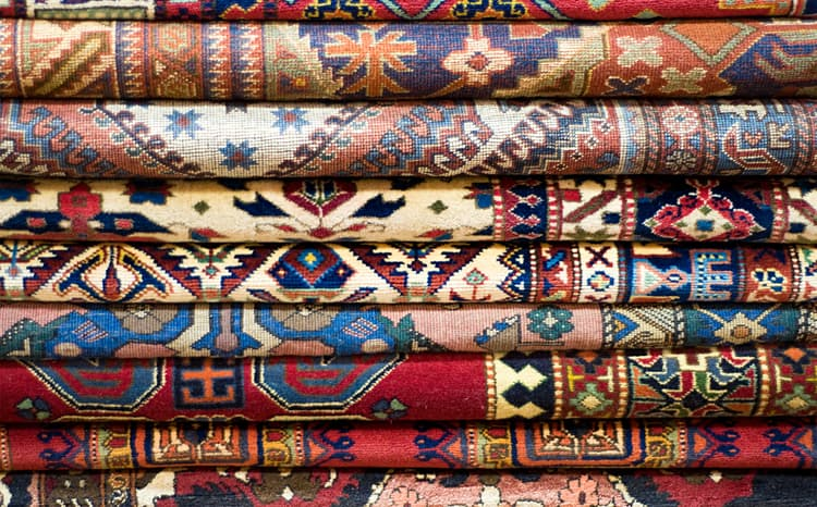 Stack of Persian Rugs